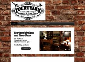 courtyardantiquesolympia.com